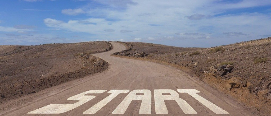 Start sign on a dirt road