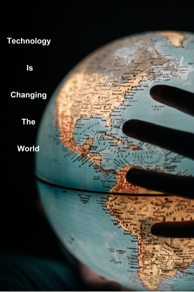 Hand on globe