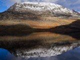 Pen Yr Ole Wen is reflected in Llyn Ogwen