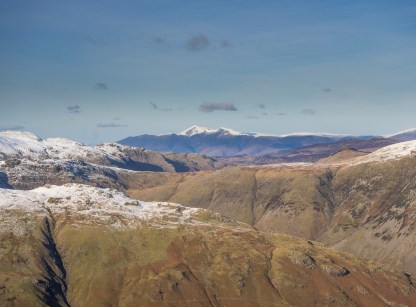 Skiddaw in the distance from Cold Pike summit looking over the head of Langdale