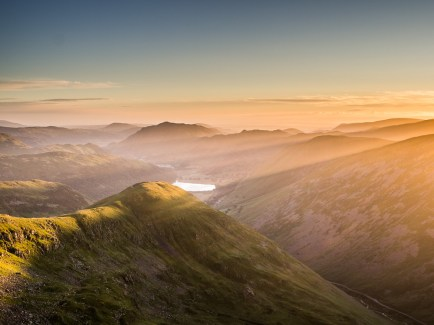 The sun just risen above the horizon casts heavenly rays across the valley and lights up Middle Dodd