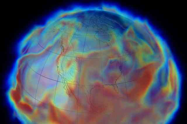 Simulated image of Earth centering on North America, with colorful red, green and blue wavy layers, simulating global humidity in June 1993