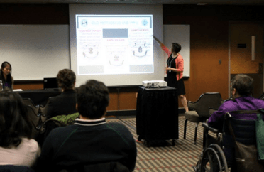 Emily presenting at the GAC, via COGS