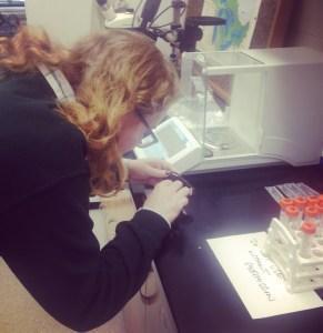 Becca Alberts performing macrobotanical analysis