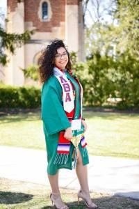undergraduate Breanna Escamilla in cap and gown