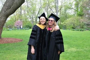 Lissie Arndt and Dr. Linda Hunt smiling in graduation regalia