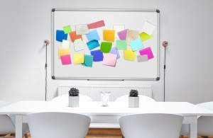 whiteboard with different colored sticky notes