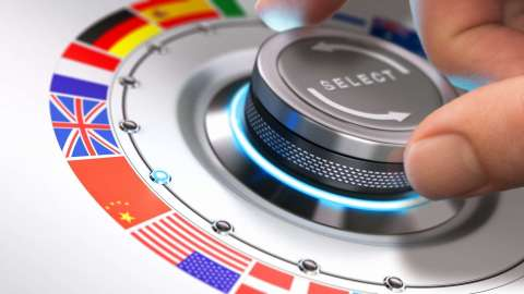 Hand on a dial with languages to choose from