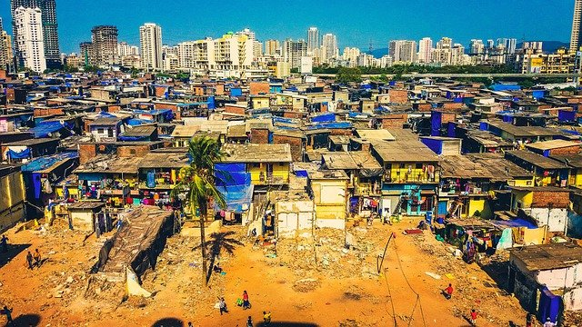"""""""Slum"""" area outside of a city, showing crowded shack housing."""