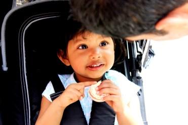 Asha eating a strawberry macaroon