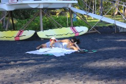 relaxing at the black sand beach. Big Island.