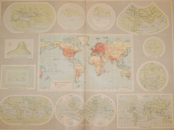 Large vintage world map from 1922 titled Mapping The World. The map contains a world map in the centre and 11 smaller maps around this map.