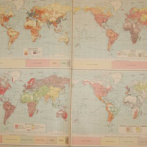 Large vintage map from 1922 titled World Population. The map is broken into four quadrants each containing a smaller world map focusing on different elements, population, race, religions and languages of the time.