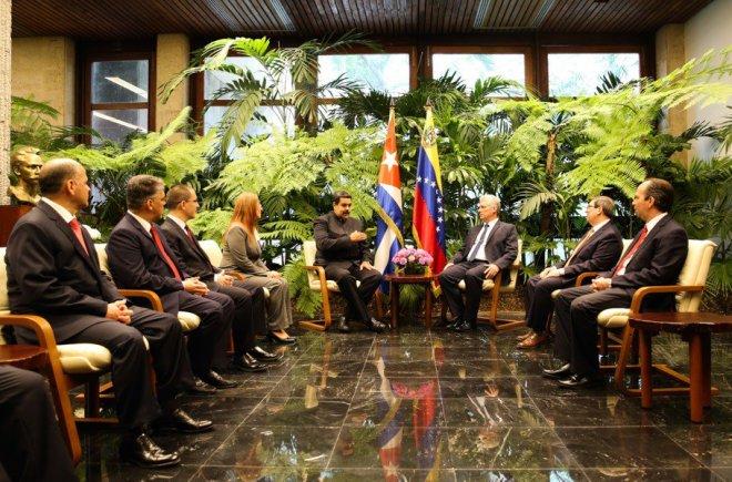 Miguel Diaz-Canal sits with Venezuela's Nicolas Maduro.