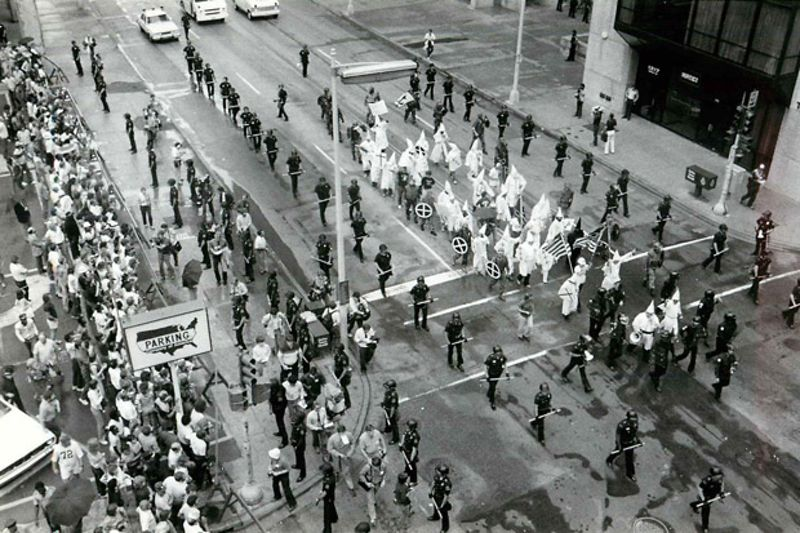 Dallas Police Department protecting the KKK during their 1983 march through downtown.