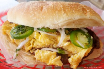 © Typical Guatemalan Breakfast Sandwich: Pirujo con huevo y frijoles by Rudy Giron
