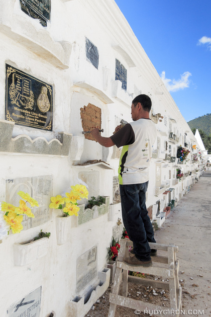 Rudy Giron: Antigua Guatemala &emdash; Doing repairs at a niche inside Antigua Guatemala cemetery