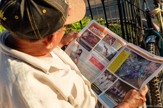 Rudy Giron: Antigua Guatemala &emdash; Man reading newspaper at Parque Cental in Antigua Guatemala