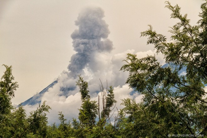 Rudy Giron: Antigua Guatemala &emdash; Volcán Fuego erupting through the clouds