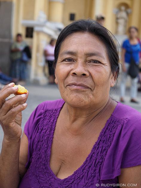Rudy Giron: Antigua Guatemala &emdash; Guatemalan woman eating jocotes
