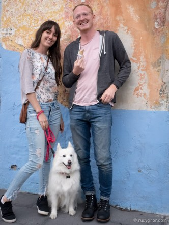 Couple walks their dog Luna on the streets of Antigua Guatemala by Rudy Giron