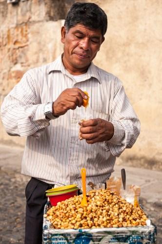 Ambulant peanuts vendor from Antigua Guatemala BY RUDY GIRON