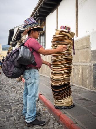 Hats Ambulant Vendor in Antigua Guatemala BY RUDY GIRON