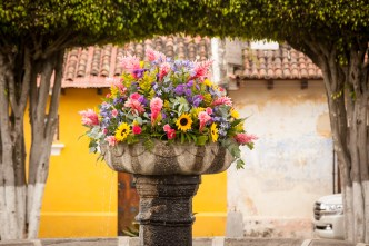 Fountain Decorated with Flowers in Antigua Guatemala BY RUDY GIRON
