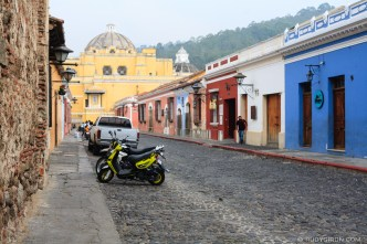 PHOTO STOCK: Man walks with a face mask through the nearly empty street of Calle del Arco in Antigua Guatemala