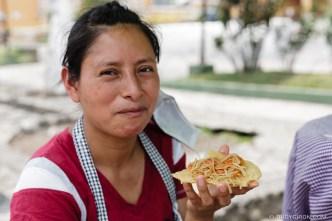 PHOTO STOCK: Woman enjoying a chow mein tostada