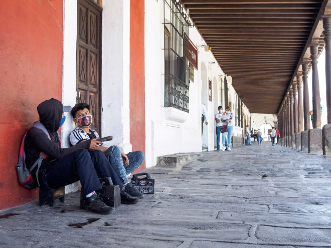 PHOTO STOCK: Sights of Our Times — Shoe shiners waiting for clients