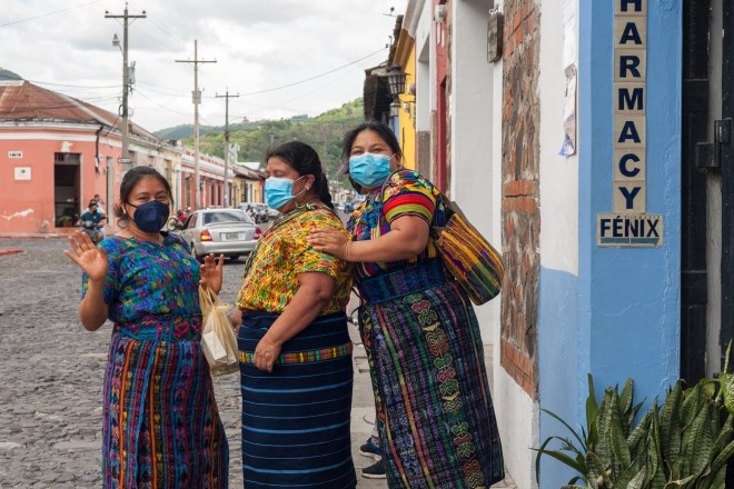 PHOTO STOCK: Mayan women smiling after buying meds at the pharmacy.