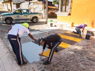 PHOTO STOCK: Repainting The Speed Bumps