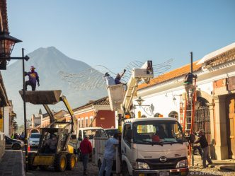 PHOTO STOCK: Removing Christmas Decorations at Calle del Arco, Antigua Guatemala
