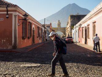 PHOTO STOCK: Man walks in the early morning by Arco de Santa Catalina in Antigua Guatemala.