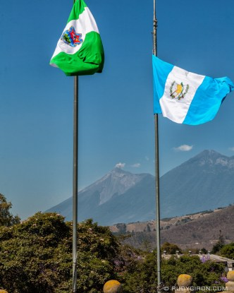 PHOTO STOCK: Volcanoes Fuego and Acatenango Framed with Guatemalans Flags