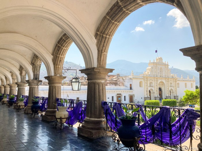 PHOTO STOCK: Former Cathedral from Antigua Guatemala framed through the arches of the Ayuntamiento Palace