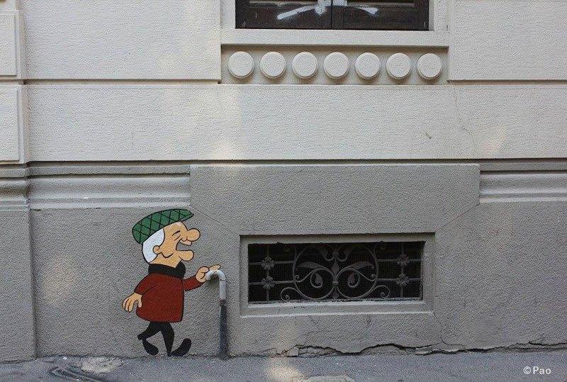 Τέχνη του δρόμου με  το  χαρακτήρα κινουμένων σχεδίων Mangoo.