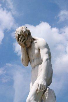 sad_statue