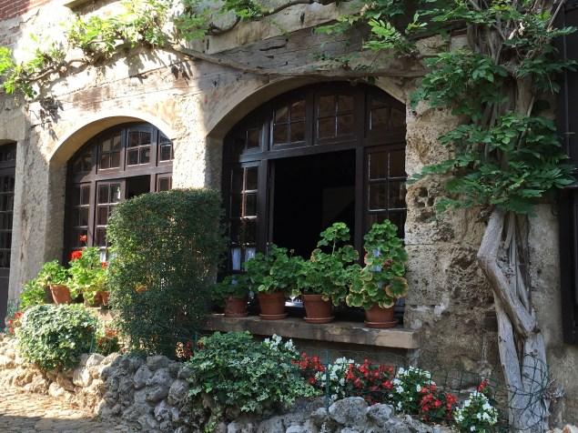 open-window-with-geraniums