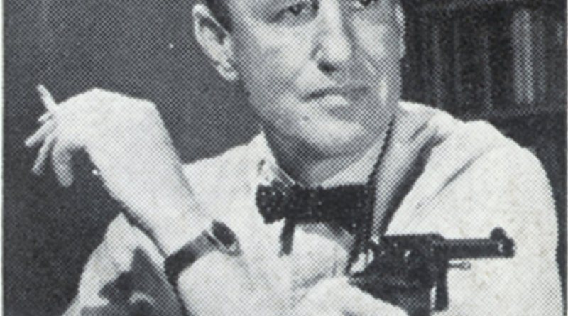 Ian Fleming with his colt Python .357 magnum revolver