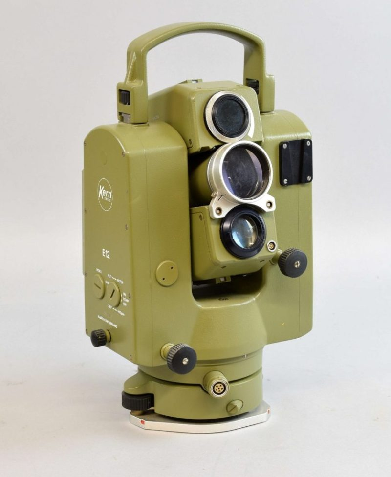 A Kern E12 electronic Theodolite from the 1990s, including a box of prisms and battery