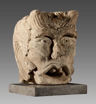 Antique stone head