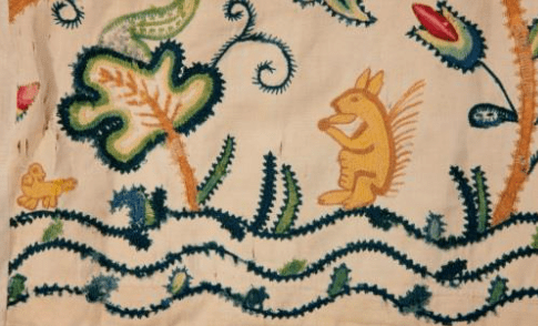 Antique crewelwork with a small squirrel