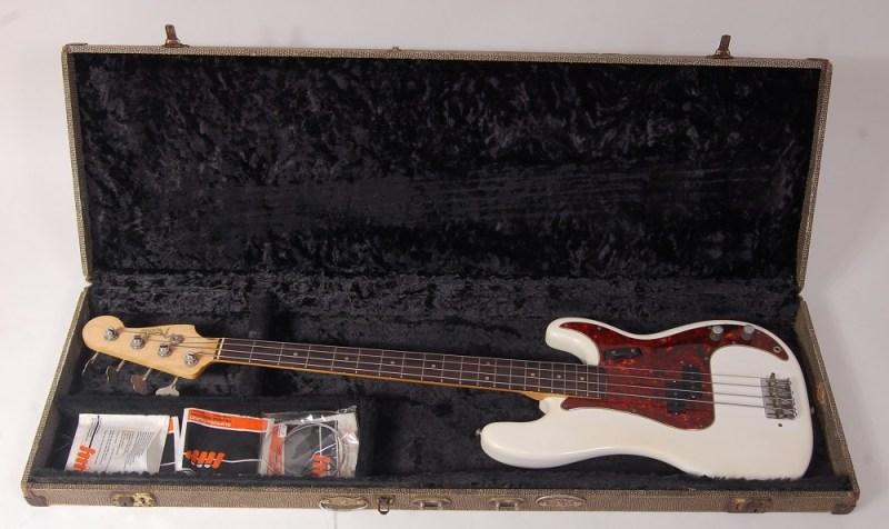 A 1963 Fender Precision bass guitar in white
