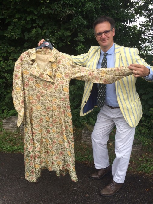 Prince Albert's dressing gown being held by auctioneer Charles Hanson
