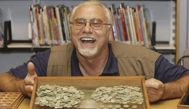Dave Crisp with the haul of Roman coins from the Frome Hoard