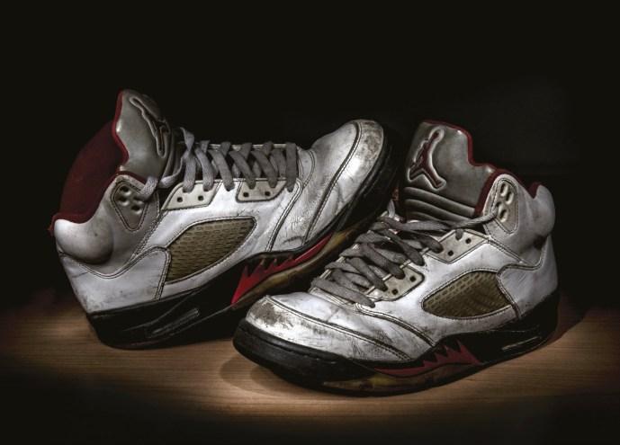 Pair of vintage well worn white Nike Jordan V shoes, image Shutterstock