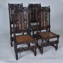 Set of four walnut caned side chairs