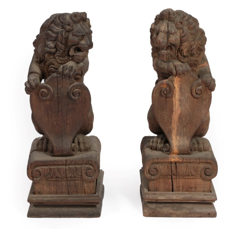 A pair of antique carved lions